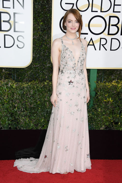 "Emma Stone took celestial motifs to new heights and cheekily nodded to LaLa Land's ""City of Stars"" theme song  at the 2017 Golden Globes in Valentino Haute Couture. The delicate pale ivories, nudes and metallics of her look were subtle against her pale complexion, and paved the way for her stellar Tiffany & Co. collar to complement the look without appearing overdone.  Get the Look: Valentino long dress in embroidered tulle, $7,160, valentino.com."