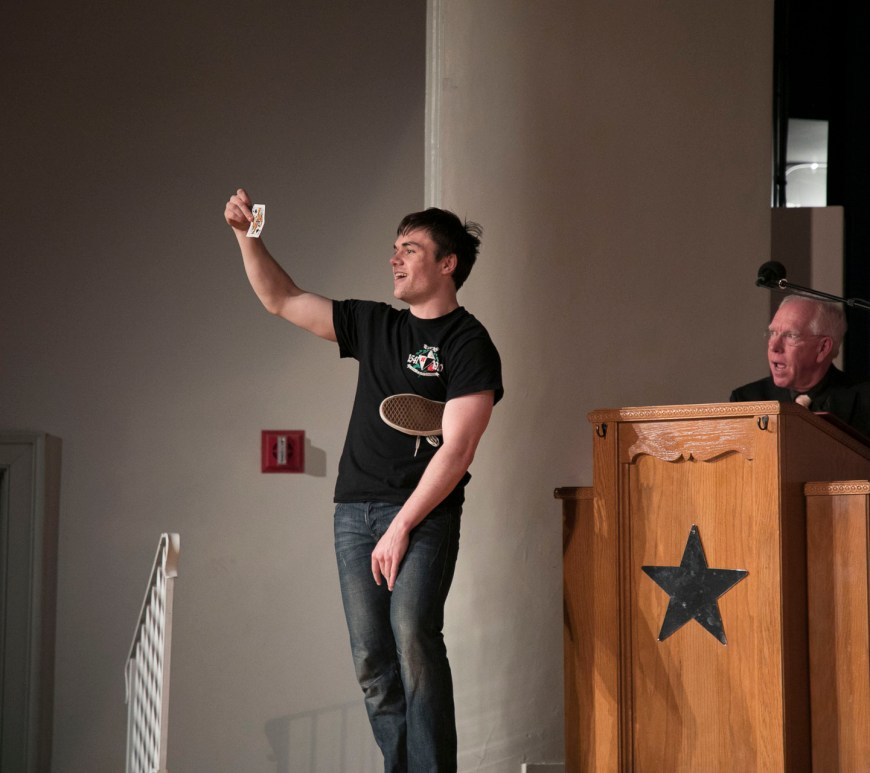 Mr. Eta Phi Lambda Kevin Toner, junior foreign exchange student, does a card trick during the annual Mr. and Ms. Bronco competition.