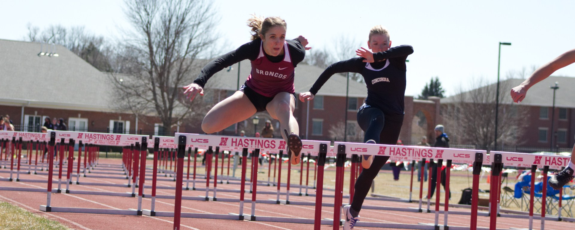 First-year student Lexi Preissler jumps over a hurdle while passing her competition. Preissler was able to place third in the 400-meter hurdles and place in two other events as well.