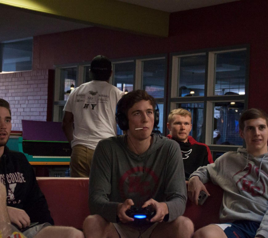 Sophomore Austin Esch and Juniors Brendan Lipovsky and Logan Cale watch Junior Ryan Ierna as he plays Fortnite in the Hazelrigg Student Union.