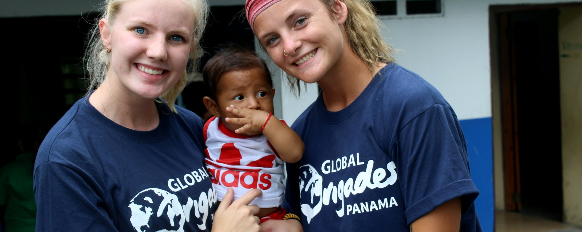 Junior Emma Johnson and Sophomore Baleigh Abbott get a photo with one of the patients from their clinics.