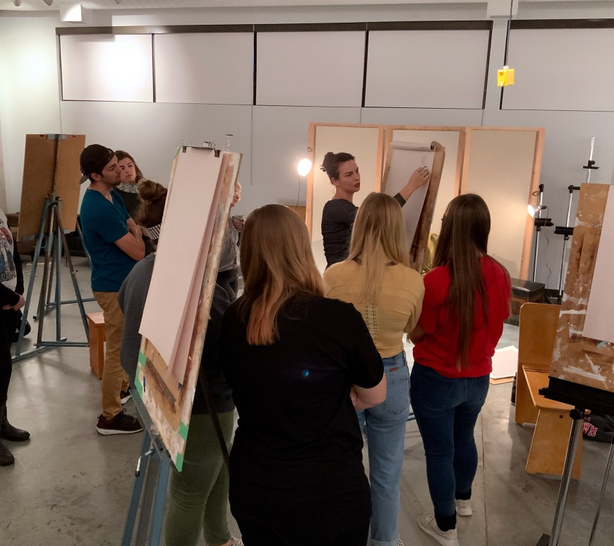 Fremaux instructs students during her open figure drawing session on portrait drawing.