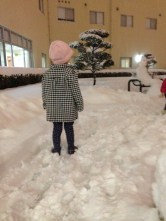 Eden admiring someones snowman