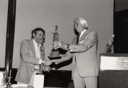 Norman receives an award from Dick Pew (right) at the ACM CHI Conference on Human Factors in Computing System in Boston, MA in April 1986.