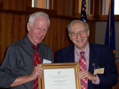 Clem MacDonald of NIH gives Ben Shneiderman a certificate for his participation in the National Library of Medicine's Board of Scientific Counselors, in Bethesda, MD in September 2010.