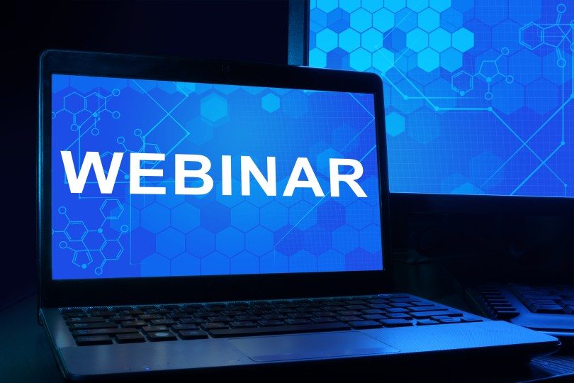 Computer with the words webinar