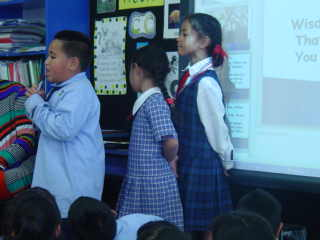One of our songs has three students leading in solos. We sing each verse after them.
