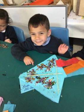 Brandon is proud of his Matariki kite. It has the seven stars of Matariki on it!