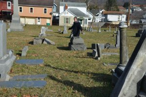 a picture of Shaun Jedju on his rounds walking through the cemetery.