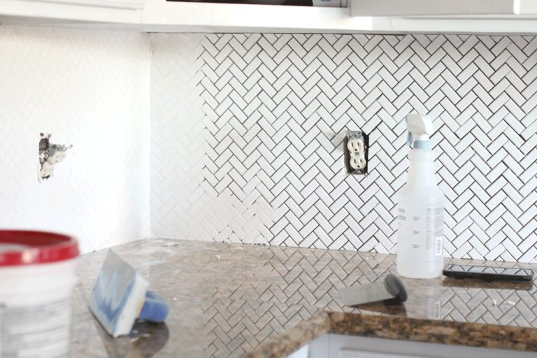 Lolly Jane's kitchen backsplash mid-grouting.