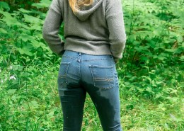 Alisha shows off the backside of her jeans after peeing herself.
