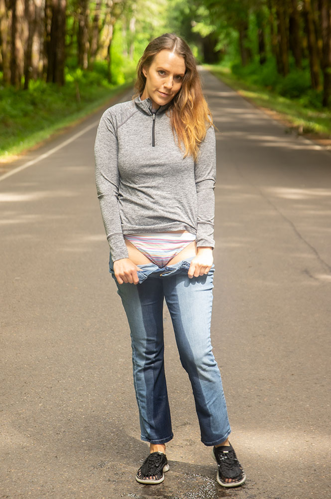Alisha shows off her wet panties after peeing herself in the middle of the street.