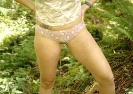 Peeing through her pink panties.