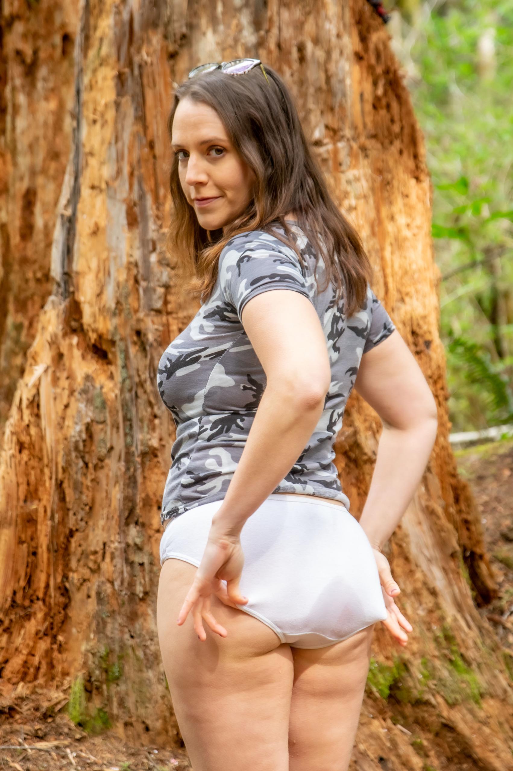 Alisha shows off her ass in her wet panties.
