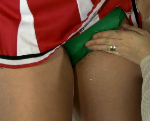 Close-up shot of Olivia peeing in her panties as Lola rubs her.