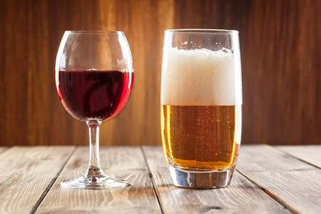 32013634-red-wine-glass-and-glass-of-light-beer