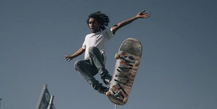 Man falling off skateboard after difficult move. He will learn more from this experience than if he'd succeeded.