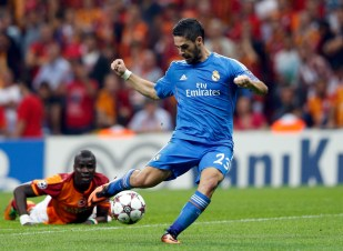 Real Madrid's Isco shoots to score against Galatasaray during their Champions League soccer match in Istanbul