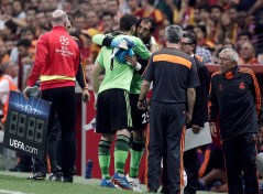 Real Madrid's goalkeeper Casillas hugs Lopez as his is replaced after an injury during their Champions League soccer match against Galatasaray in Istanbul