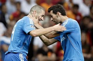 Real Madrid's Benzema celebrates a goal with team mate Arbeloa against Galatasaray during their Champions League soccer match in Istanbul