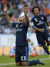 Real Madrid's Brazilian defender Danilo celebrates after scoring a goal during the Spanish league football match Celta Vigo vs Real Madrid CF at the Balaidos stadium in Vigo on October 24, 2015. AFP PHOTO / MIGUEL RIOPA (Photo credit should read MIGUEL RIOPA/AFP/Getty Images)