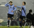 Uruguay's Diego Forlan (L) celebrates with teammate Diego Lugano after scoring against Peru during their World Cup 2010 qualifying soccer match in Centenario stadium in Montevideo June 17, 2008. REUTERS/Andres Stapff (URUGUAY)