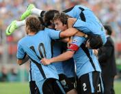 Uruguayan defender Diego Lugano (C) celebrates with teammates the second goal of his team against Paraguay during their FIFA World Cup South Africa-2010 South American qualifier football match, at the Centenario Stadium in Montevideo on March 28, 2009. AFP PHOTO / Marcos MIRAS (Photo credit should read MARCOS MIRAS/AFP/Getty Images)