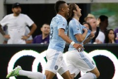 New York City FC's Mix Diskerud, right, celebrates after making a goal against Orlando City SC and runs down the field with teammate Khiry Shelton, left, during the second half of an MLS soccer game, Sunday, March 8, 2015, in Orlando, Fla. The game ended in a 1-1 tie. (AP Photo/John Raoux)