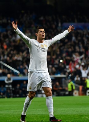 Real Madrid's Portuguese forward Cristiano Ronaldo celebrates after scoring during the UEFA Champions League Group A football match Real Madrid CF vs Malmo FF at the Santiago Bernabeu stadium in Madrid on December 8, 2015. AFP PHOTO/ PIERRE-PHILIPPE MARCOU / AFP / PIERRE-PHILIPPE MARCOU (Photo credit should read PIERRE-PHILIPPE MARCOU/AFP/Getty Images)