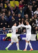 Real Madrid's Colombian midfielder James Rodriguez (L) and Real Madrid's Portuguese forward Cristiano Ronaldo celebrate after a goal during the UEFA Champions League round of 16, second leg football match Real Madrid FC vs AS Roma at the Santiago Bernabeu stadium in Madrid on March 8, 2016. / AFP / JAVIER SORIANO (Photo credit should read JAVIER SORIANO/AFP/Getty Images)