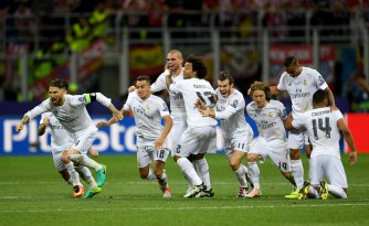 MILAN, ITALY - MAY 28: Real Madrid players celebrate celebrates after winning the Champions League Final after Cristiano Ronaldo scored the winning penalty in the penalty shoot out during the UEFA Champions League Final match between Real Madrid and Club Atletico de Madrid at Stadio Giuseppe Meazza on May 28, 2016 in Milan, Italy. (Photo by Laurence Griffiths/Getty Images)