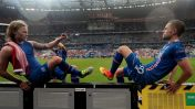 Iceland's midfielder Birkir Bjarnason (L) and Iceland's midfielder Gylfi Sigurdsson celebrate after the Euro 2016 group F football match between Iceland and Austria at the Stade de France stadium in Saint-Denis, near Paris on June 22, 2016. / AFP / KENZO TRIBOUILLARD (Photo credit should read KENZO TRIBOUILLARD/AFP/Getty Images)