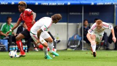 Austria's midfielder David Alaba (L) vies for the ball against Hungary's defender Tamas Kadar (2nd L) and Hungary's midfielder Laszlo Kleinheisler during the Euro 2016 group F football match between Hungary and Austria at the Matmut Atlantique stadium in Bordeaux on June 14, 2016. / AFP / MEHDI FEDOUACH (Photo credit should read MEHDI FEDOUACH/AFP/Getty Images)