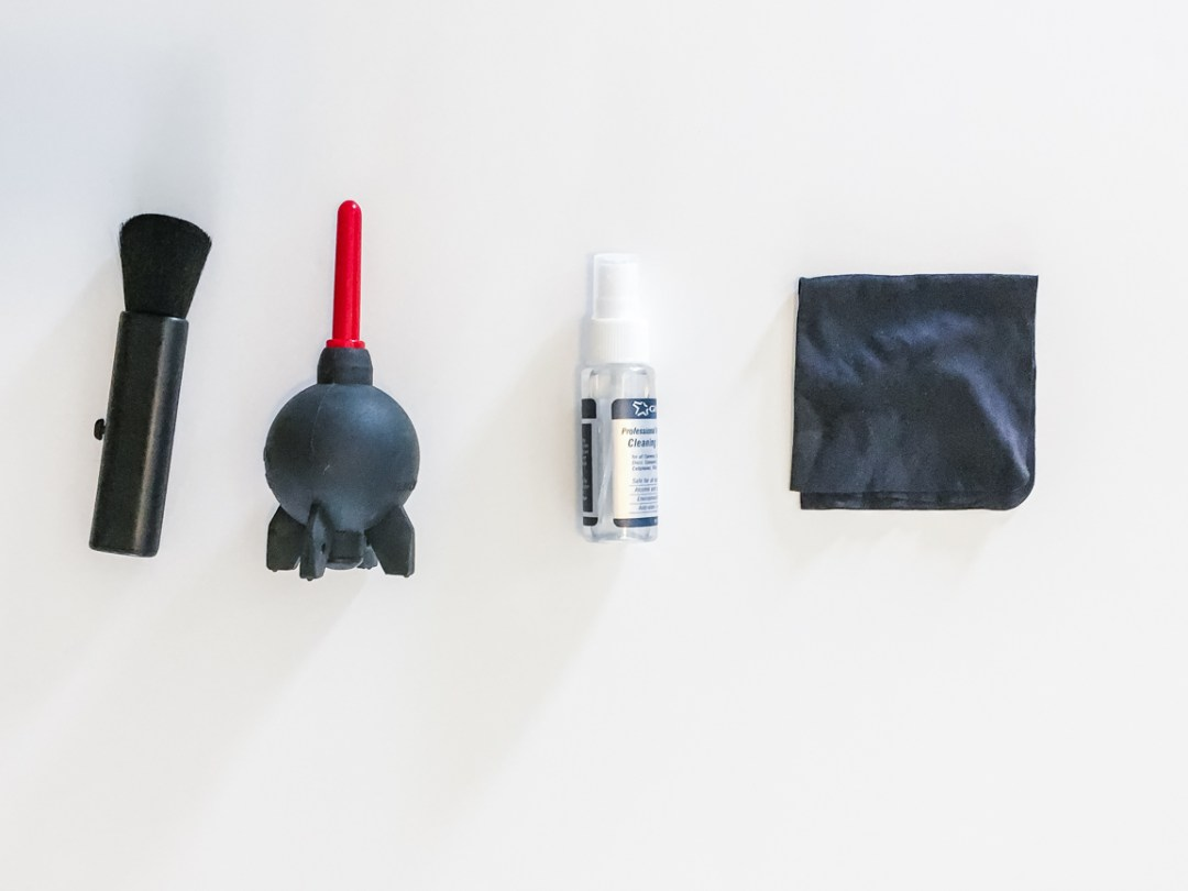 Layflat of camera cleaning supplies on a white background