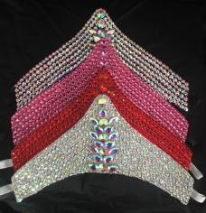 These Iconic Crystalized Headbands are 11 inches wide and 5 inches tall, and are completely covered in crystals. $95.00/each