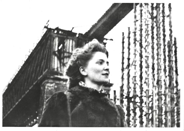 Lucie at a destroyed train station at Stuttgart, Germany after WWII, 1945