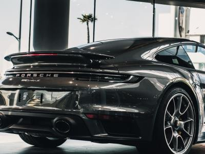 black porsche from behind