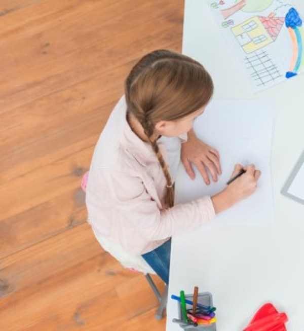 overhead-view-female-psychologist-making-note-sitting-with-girl-drawing-paper_23-2148026279 - cropped