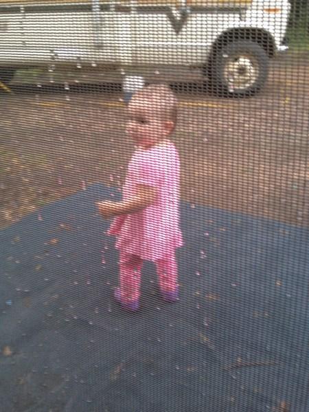 Sasha outside the rPod's tent in the rain.