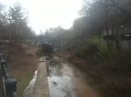 The view down Hooff's Run from the Duke Street bridge, showing the putative 1848 rail bridge in the distance.