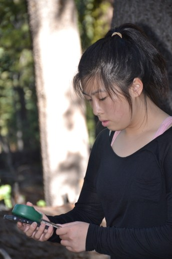 A Quarry Lane student learning about soil moisture during her school field trip to the Sierra.