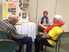 Brian and Ginny listen as a BRC resident shares flood memories.