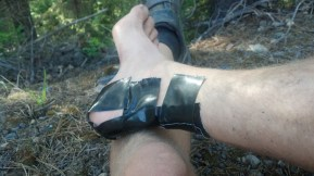 All I had was duct tape at the time, didn't work to well. This was on Huckleberry Pass. A lady stopped and asked how far it was until the highway. Turns out it was Lincoln's Physical Therapist Karen Wilson. She came in early the next morning and got my ankles all taped up.