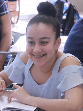 A HEAF student enjoys math class.