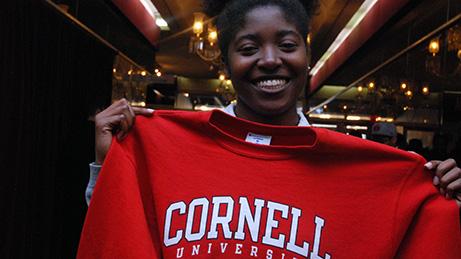 A HEAF student holds her Cornell University sweatshirt