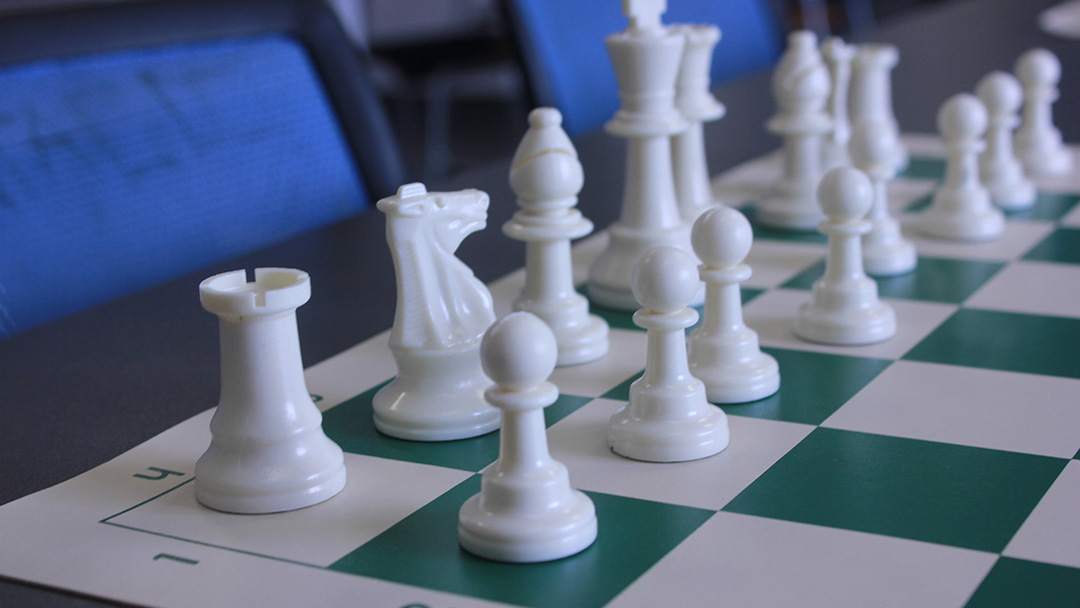 A chess board with the pieces set up for a game