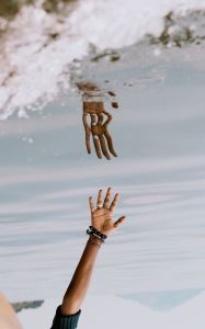 Hand reflected in water upside down