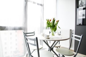 Kitchen table with tulips on it, white colour scheme