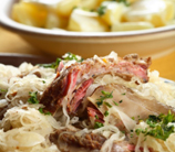 Slow-Roasted Cider Pork Loin with Cabbage