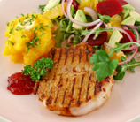 Spice-Rubbed Pork Chops with Raspberry-Mango Salsa